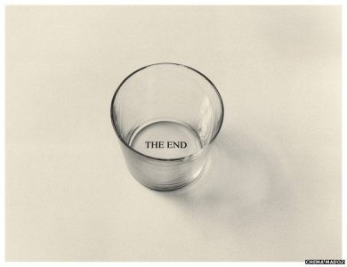 "empty glass with the words ""The End"" imprinted on the bottom"