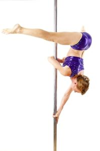 woman upside down on a pole, wearing purple two piece sparkly swimsuit