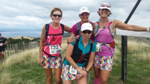 4 female walkers at the highest point of the Oxfam Trailwalk. Clouds in a sunny sky.