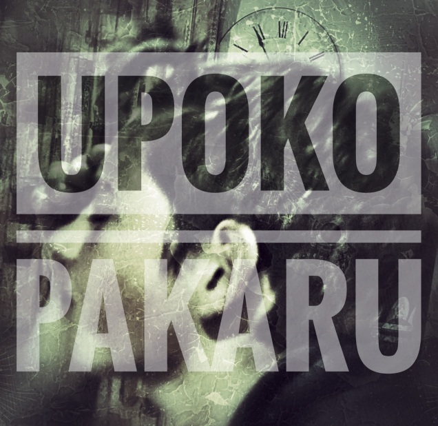a black and grey photo of a boy, head in hands and the words Upoku Pakaru