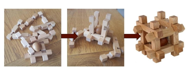 wooden puzzle showing stages of development - jumbled, almost complete, complete
